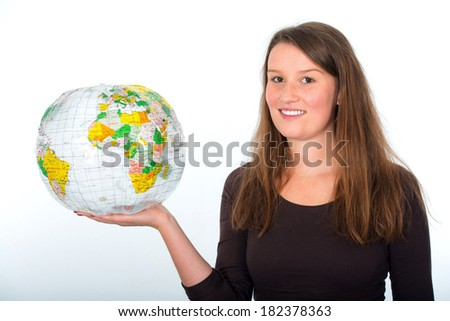 Young woman with a globe