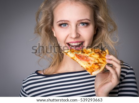 Young woman with a piece of pizza in his hand