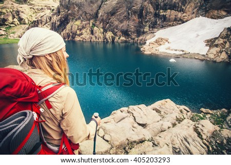 Young Woman with backpack hiking Travel Lifestyle concept blue lake on background vacations adventure journey outdoor