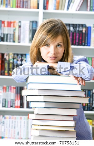 Young woman with books for reading in the library
