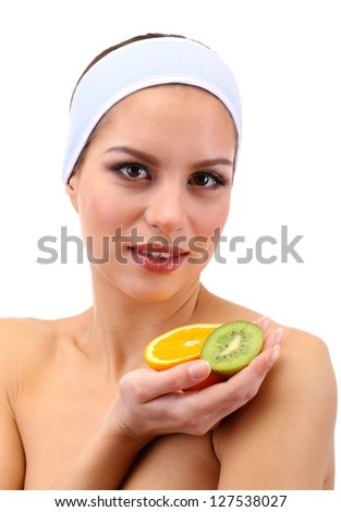 Young woman with fruit.Concept: Facial fruit masks. Isolated on white