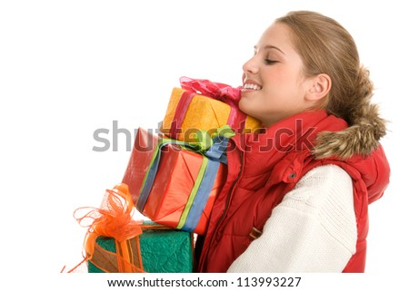 Young woman with pile of gifts
