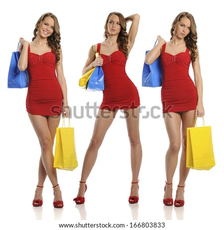 Young Woman with shopping bags and red dress isolated on a white background