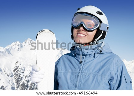Young woman with ski against mountains