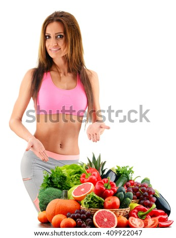 Young woman with variety of organic vegetables and fruits.