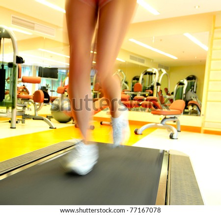 young woman workout while run on track in sport club