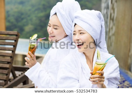 young Women relaxing and drinking tea after spa