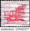 YUGOSLAVIA - CIRCA 1986: A stamp printed in Democratic Federation of Yugoslavia  shows Postal Services, Forklift truck, circa 1986 - stock photo