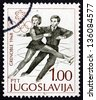 YUGOSLAVIA - CIRCA 1968: a stamp printed in the Yugoslavia shows Figure Skating Pair, Figure Skating, Pair, Winter Olympic sports, Grenoble 68, circa 1968 - stock photo