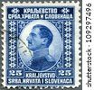 YUGOSLAVIA - CIRCA 1921: A stamp printed in Yugoslavia shows king Alexander I of Yugoslavia, circa 1921 - stock photo