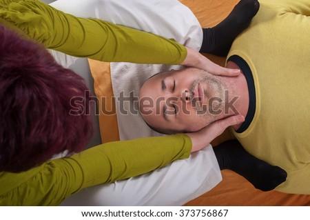 practicing acro yoga exercises group man stock photo