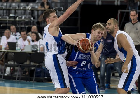 ZAGREB, CROATIA - AUGUST 27, 2015: The preparatory match ahead of the EuroBasket 2015 between Israel and Estonia. Estonian player Gert Dorbek is holding the ball.