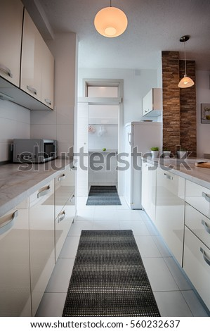 Kitchen white cabinetry stovetop island stock photo for Interior design zagreb