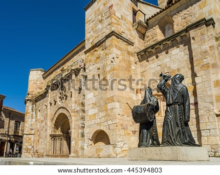 Zamora, Spain - June 20, 2016: Principal facade of Church of San Juan Bautista in mayor square of Zamora with a Merlu easter statue. Castilla y Leon, Spain.