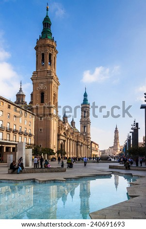ZARAGOZA, SPAIN, NOVEMBER 1, 2014: People on Plaza del Pilar square in Zaragoza, in front of Basilica de Nuestra Senora del Pilar.