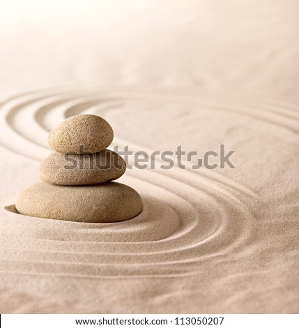 zen garden place for meditation and relaxation in Japanese culture, simplicity and harmony for concentration. Sand and stone form nice lines and pattern