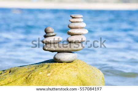zen like pebbles pyramid with sea on background