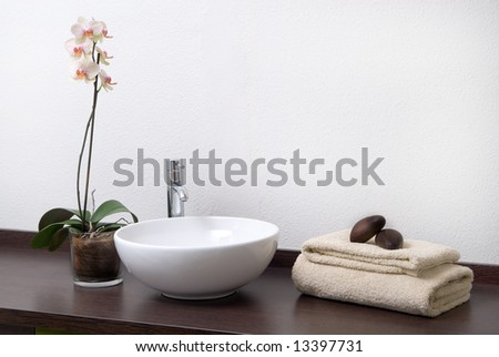 Zen scene of relaxing treatment with towels and stones