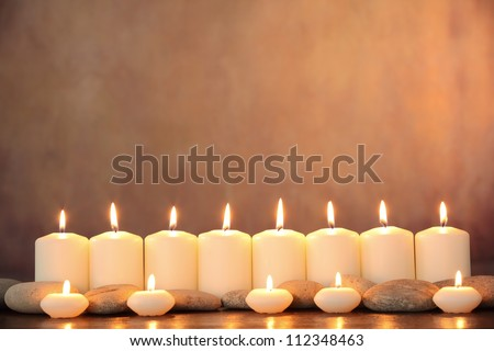 Zen stones and aromatic candles on table,Zen concept.