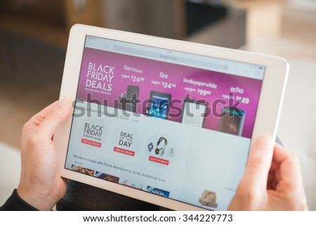 Zhongshan,China-November 27, 2015:young women shopping through tablet on Amazon on Black Friday.More & more Chinese people shopping through internet internationally.