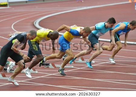 ZHUKOVSKY, MOSCOW REGION, RUSSIA - JUNE 27, 2014: Start of men 100 meters during Znamensky Memorial. The competitions is one of the European Athletics Outdoor Classic Meetings