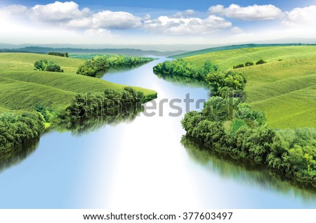 Zigzag river flows between summer valleys.a