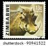 ZIMBABWE - CIRCA 1985: a stamp printed by Zimbabwe shows Warthog, series animals, circa 1967 - stock photo