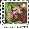 ZIMBABWE - CIRCA 1985: A stamp printed in Zimbabwe shows a rhinoceros, circa 1985 - stock photo