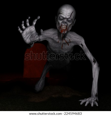 Zombie - Rising from the Grave.  A zombie has dug his way out of his grave and looks angry and hungry. Happy Halloween.