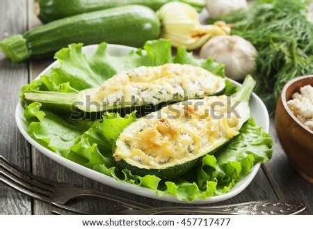 Zucchini stuffed with curd cheese and herbs