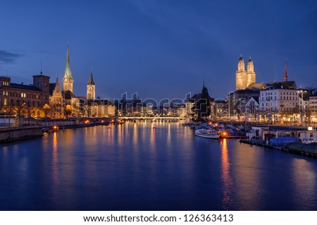 Zurich city center viewed from the river by night. Switzerland.