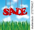 word sale on a background of blue sky and green grass.seasonal sale. - stock