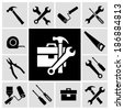 A collection of black house maintenance or renovation working tools isolated icons set of hammer wrench screwdriver and measuring tape vector illustration - stock vector