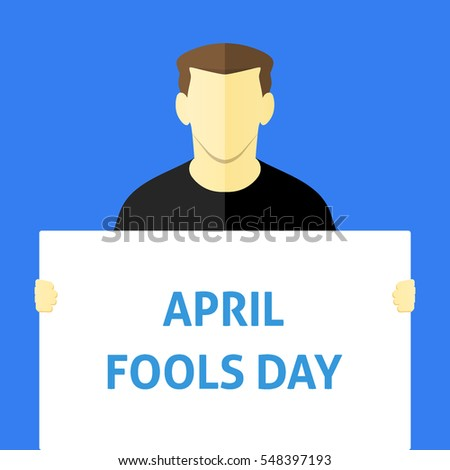April Fools Day - Man showing sign. Business person holding a white piece of cardboard