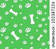 Background with dog paw print and bone on green - stock vector