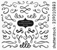 Beautiful artistic set of ink swooshes. Hand drawn decorative calligraphy elements for your design. Beautiful Swirls, Swooshes and Decorative elements for wedding invitations, cards and stationery. - stock photo