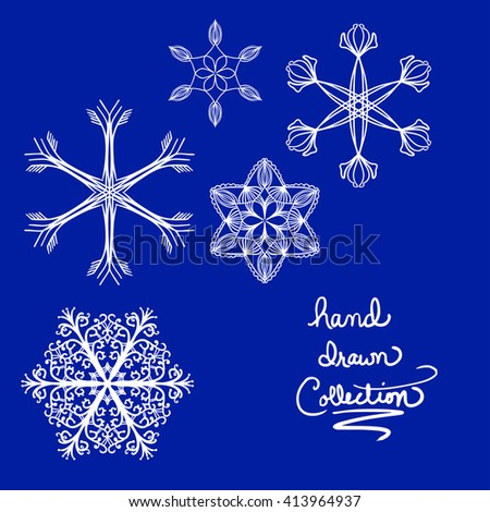 beautiful hand drawn snowflakes or symmetrical design elements vector