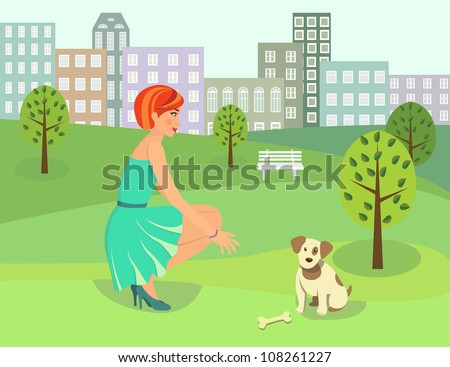 Beautiful woman with a dog in the park