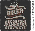 Biker style dirty letters alphabet with wings skull emblem. Dark Background. - stock vector
