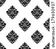 Black and white seamless pattern of diamond shaped floral arabesque motifs arranged in a repeat pattern with a wide white border in square format suitable for damask style fabric and vintage wallpaper - stock vector