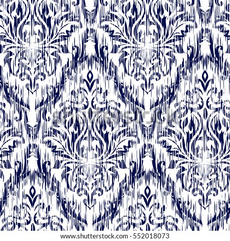Blue ikat ogee and damascus ornament seamless background pattern abstract background for textile design