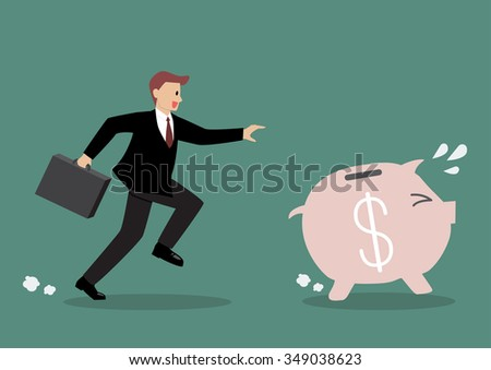 Businessman try to catch piggy bank. Business concept
