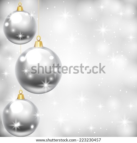 Christmas card with silver baubles on shiny background
