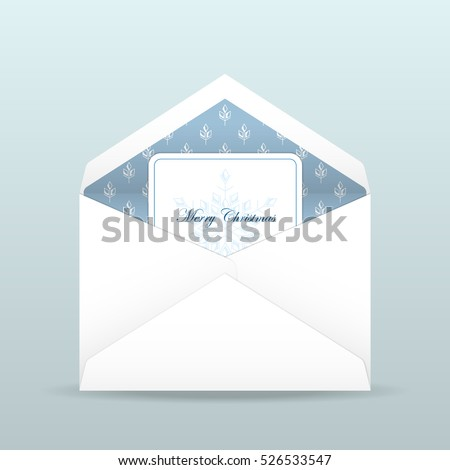 Christmas card with snowflake inside open envelope in white and blue color