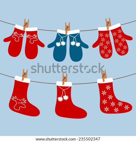 Christmas graphics with socks and gloves hanging on a string in vector