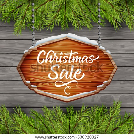christmas sale. text on wooden background with Christmas tree