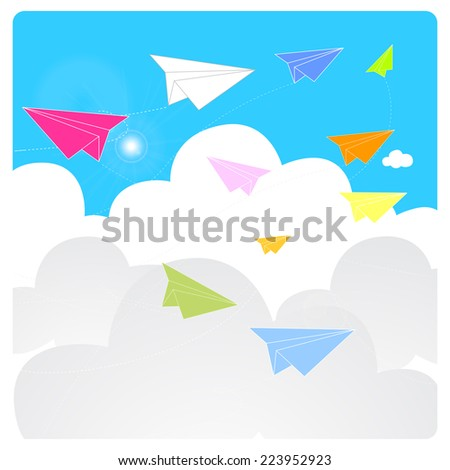 colorful origami paper planes fly on a blue sky during a clear sunny day