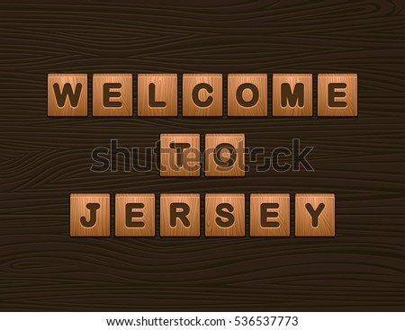 "Cubes with letters ""Welcome To Jersey"" on wooden board for Web"