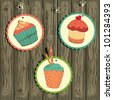 Cute retro cupcake on the string on the wooden background . Vector card. - stock vector