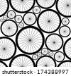 Cute vector seamless pattern with bike wheels. You can use any color of background. - stock